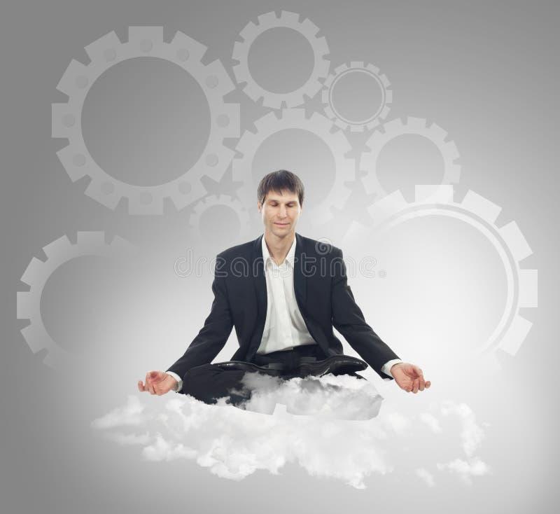 Biznesmena obsiadanie w lotosowej pozyci na chmurze zdjęcie royalty free