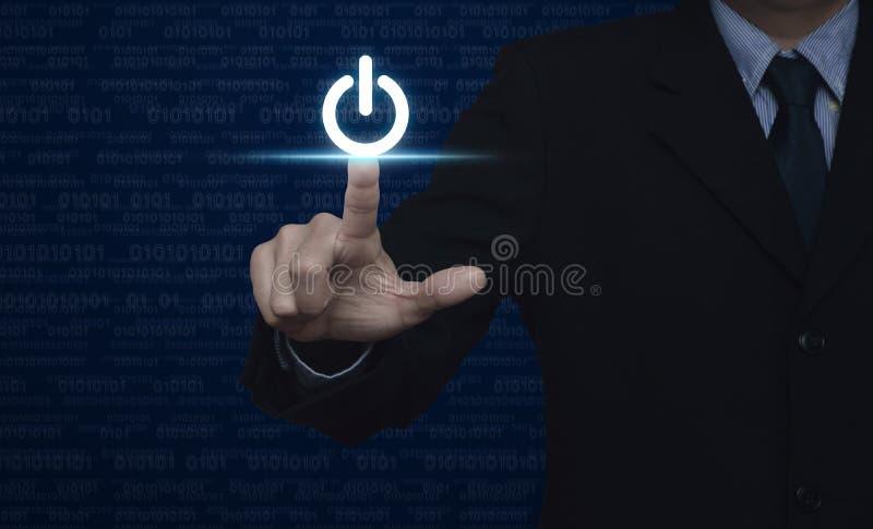 Biznesmena odciskania władzy guzik nad komputerowym binarnego kodu błękitem obrazy royalty free