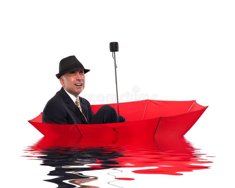 Biznesmena płacz podczas gdy unoszący się na parasolu obraz stock