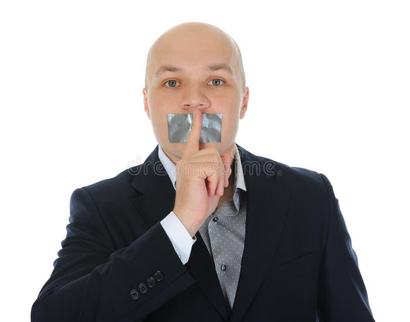 biznesmena palec potomstwa mienia jego usta fotografia stock