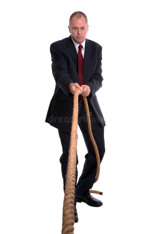 biznesmena pullings liny zdjęcia royalty free