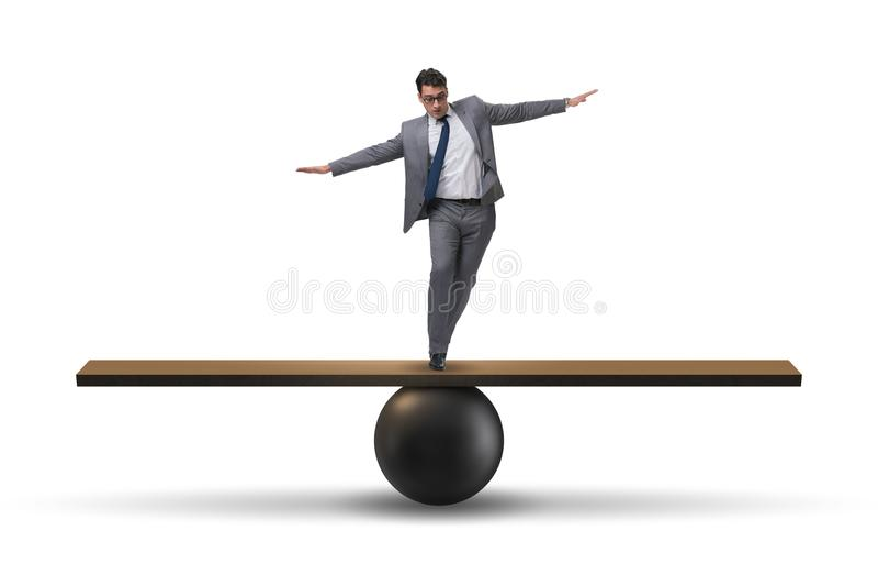 Biznesmena równoważenie na seesaw w niepewności pojęciu zdjęcie royalty free