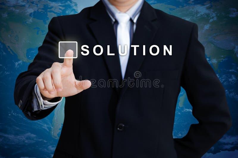 biznesmena ręki dosunięcia rozwiązanie obraz stock