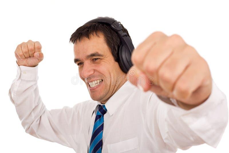 biznesmena słuchający muzyczny laszowania stres obraz royalty free