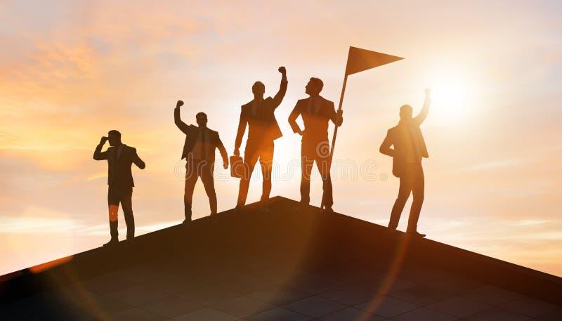 Biznesmeni w osi?gni?ciu i pracy zespo?owej poj?ciu fotografia royalty free