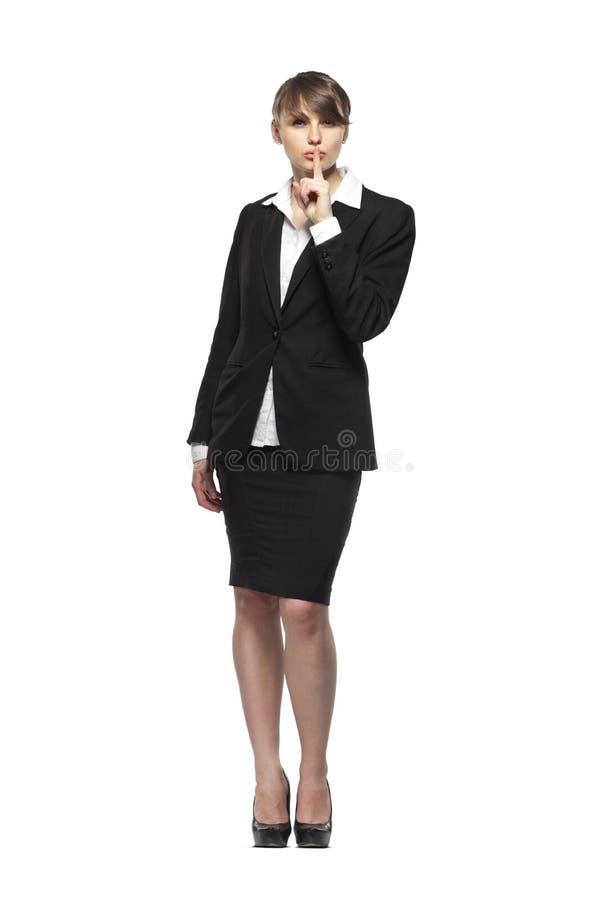 Biznesowa kobieta folował długość portret, pyta utrzymywać ciszę, odizolowywającą na białym tle obrazy stock