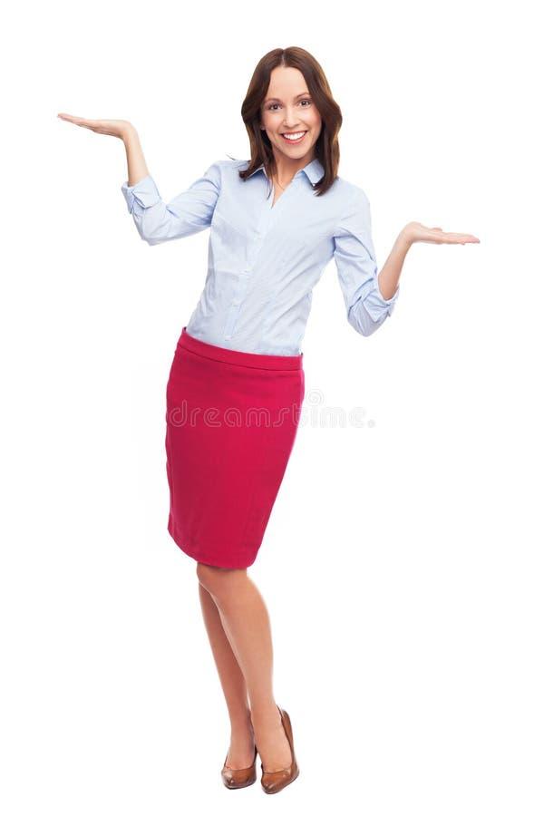 Biznesowa kobieta przedstawia twój produkty obraz royalty free