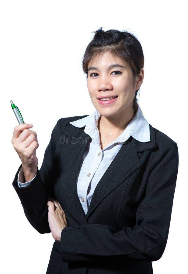 Biznesowa kobieta trzyma pióro, biznesowego pojęcia myślący sukces fotografia royalty free