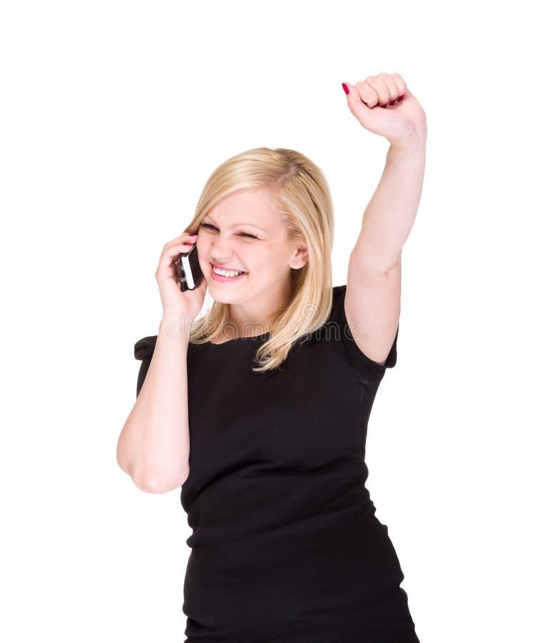 Biznesowa kobieta wygrywa nad bielem na telefonie obraz stock
