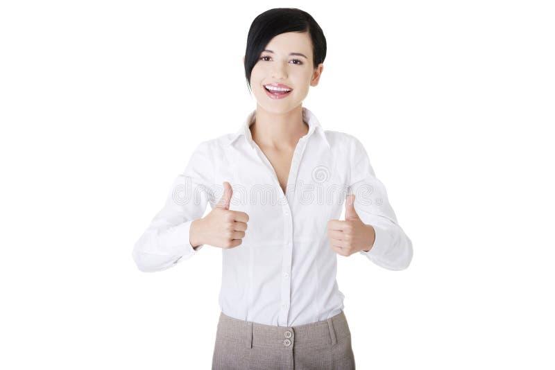 Biznesowa kobieta z aprobatami, ok gest obrazy stock