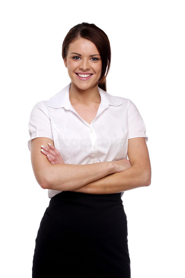 Biznesowa kobieta z fałdowymi rękami odizolowywać na bielu fotografia royalty free