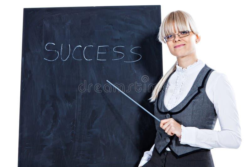 Biznesowa kobieta z kredową deską zdjęcia royalty free