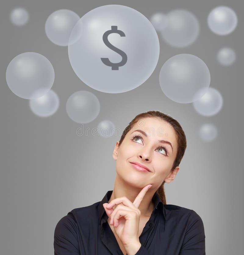 Biznesowa myśląca kobieta z dolarem obrazy stock