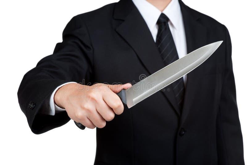 Biznesowego mężczyzna chwyta Judaszowy nóż obraz royalty free