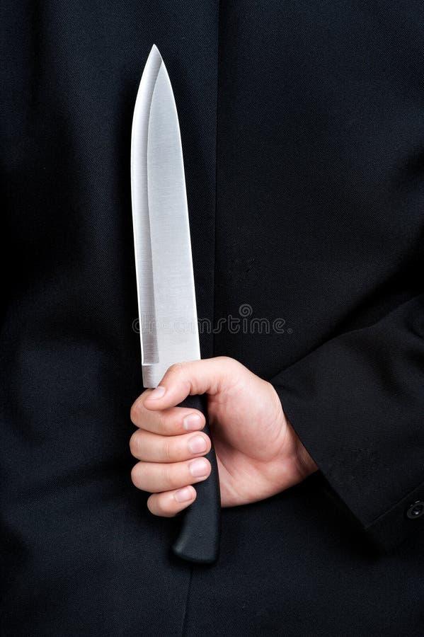 Biznesowego mężczyzna chwyta Judaszowy nóż zdjęcie royalty free