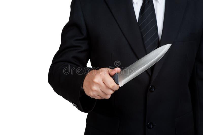 Biznesowego mężczyzna chwyta Judaszowy nóż fotografia stock