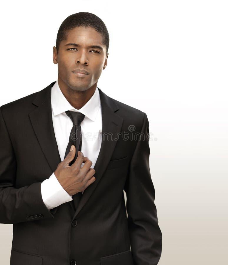 biznesowego mężczyzna kostiumu potomstwa fotografia royalty free