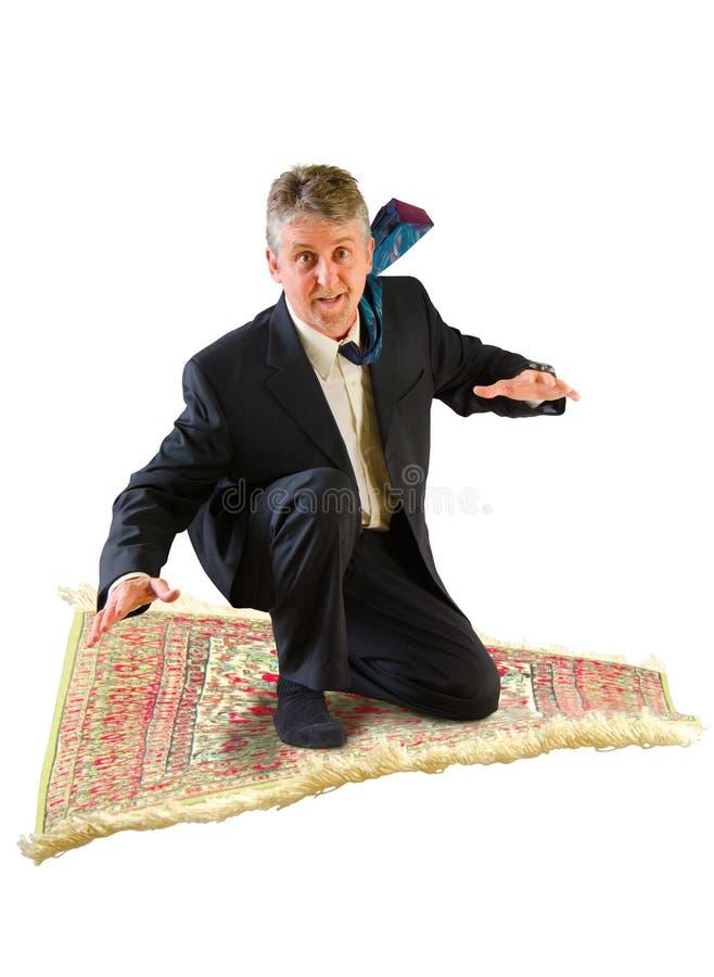Biznesowego mężczyzna latanie na magicznym dywanie obrazy royalty free