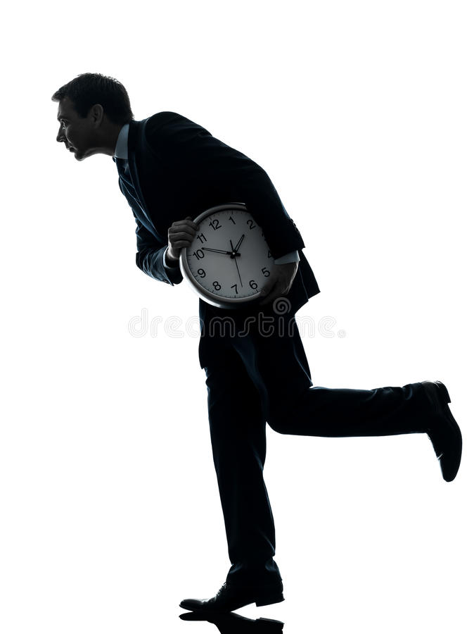 Biznesowego mężczyzna mienia czasu zegarowa obrabowywa sylwetka obraz royalty free