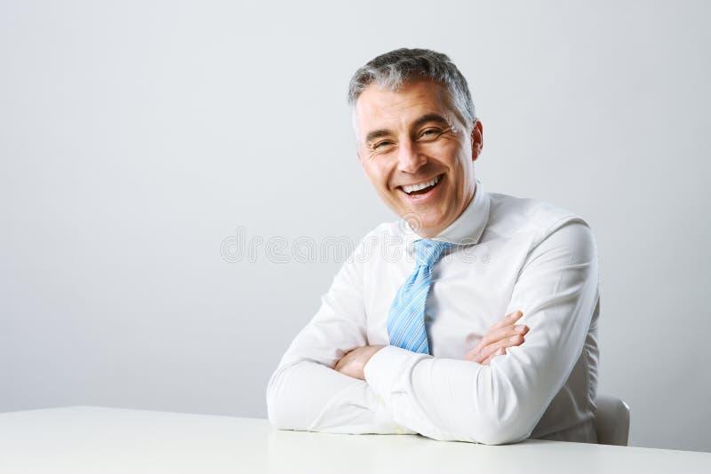 Biznesowego mężczyzna ono uśmiecha się zdjęcie royalty free