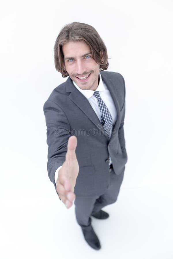Biznesowego mężczyzna przedłużyć ręka potrząśnięcie - skupia się om rękę obrazy stock
