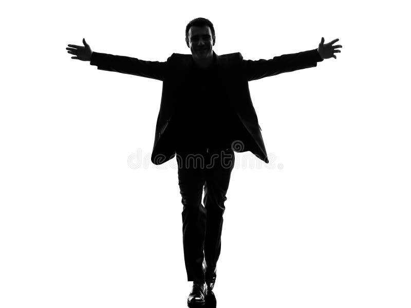 Biznesowego mężczyzna ręki szeroko rozpościerać sylwetkę obrazy stock