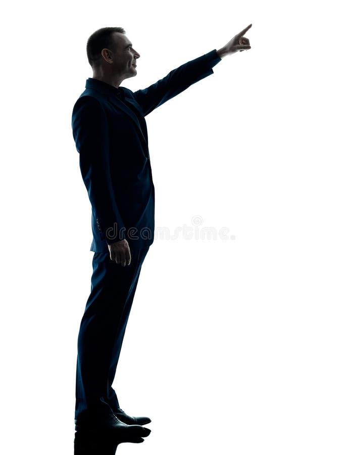 Biznesowego mężczyzna trwanie sylwetka odizolowywająca fotografia royalty free