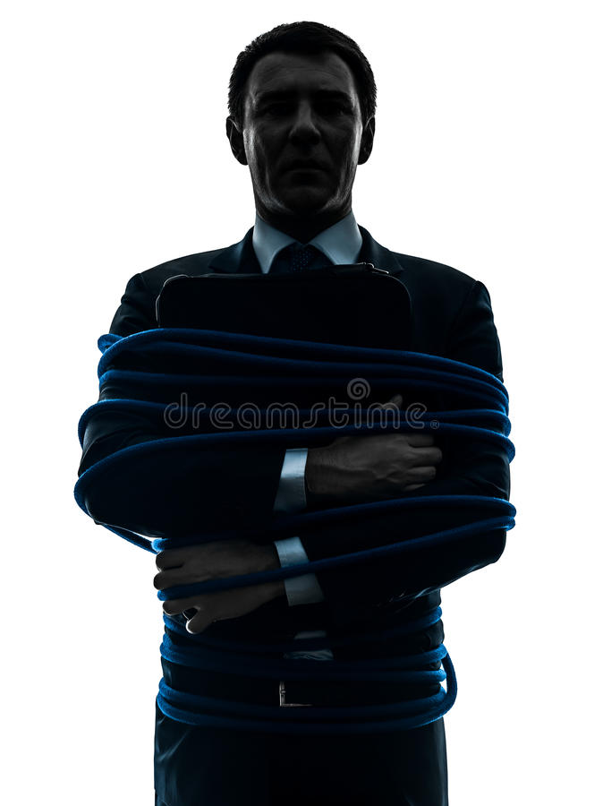 Biznesowego mężczyzna więźnia wiązana up sylwetka zdjęcia stock