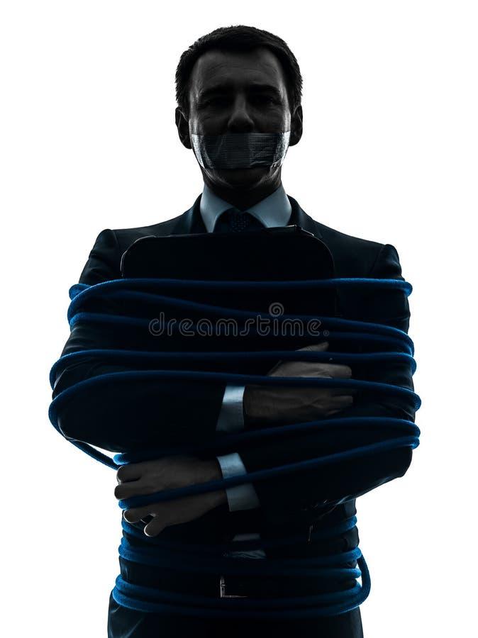 Biznesowego mężczyzna więźnia wiązana up sylwetka obraz stock