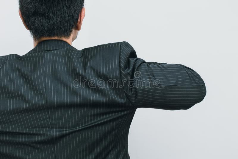 Biznesowego mężczyzna z powrotem widoku akcja przygotowywająca iść biznes obrazy stock