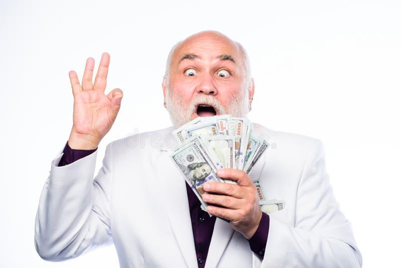 _ biznesowego poj?cia odosobniony sukcesu biel bogactwo Emerytura Szcz??liwy loteryjny zwyci?zca dojrzały brodaty mężczyzna z dol obrazy stock