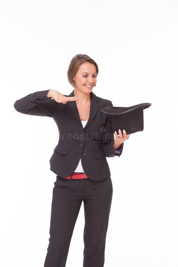 Biznesowej kobiety przedstawienia magia na bielu obrazy stock