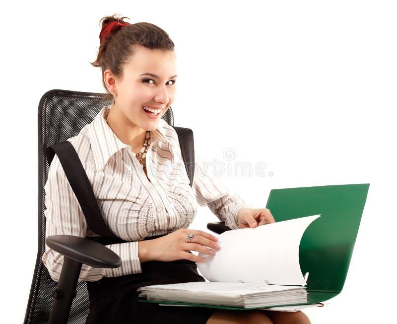 Biznesowej kobiety rozochocony działanie z dokumentami obrazy stock