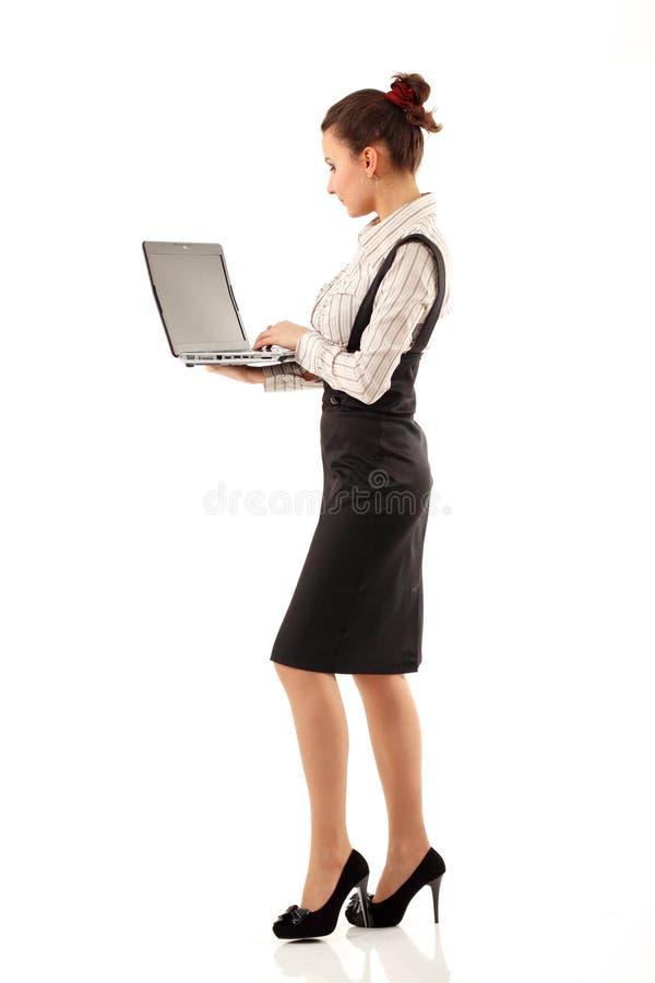 Biznesowej kobiety rozochocony pracujący notatnik zdjęcie royalty free