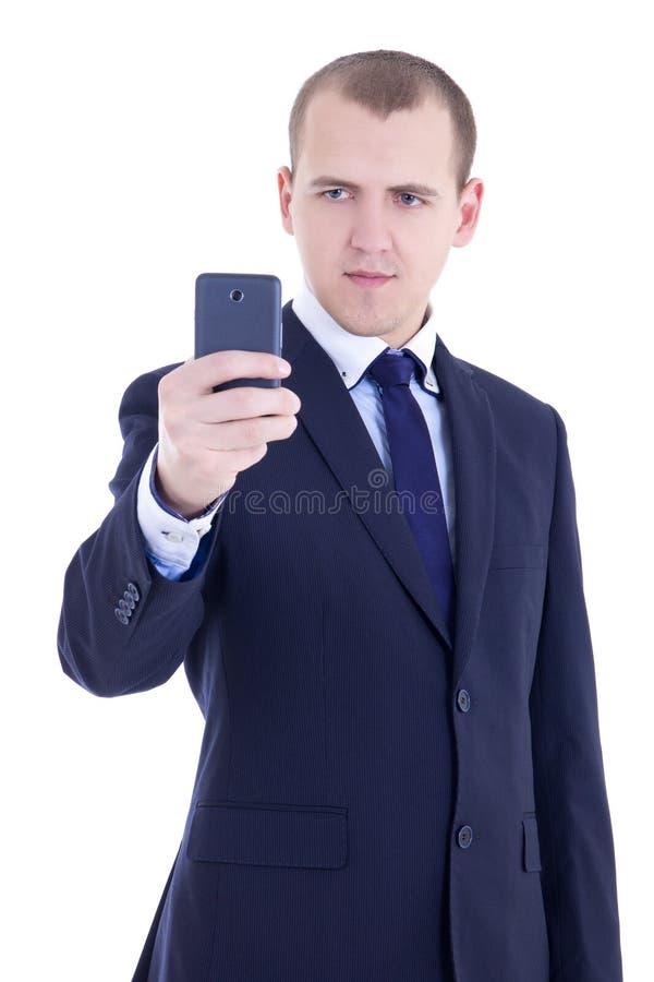 Biznesowy mężczyzna bierze fotografie z mobilną kamerą odizolowywającą na bielu zdjęcie royalty free