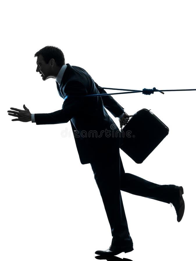 Biznesowy mężczyzna catched lasso arkany sylwetką obraz stock