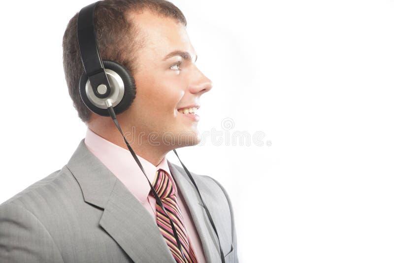 Biznesowy mężczyzna cieszy się przyjemną muzykę fotografia stock