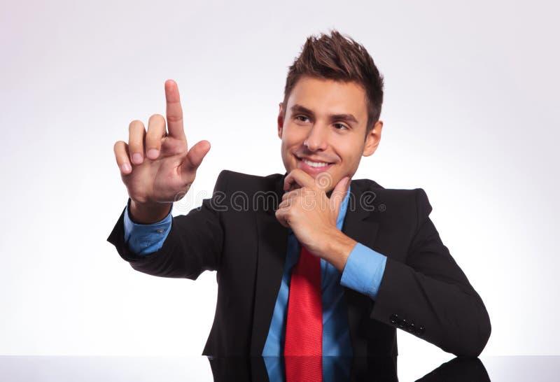 Biznesowy mężczyzna dotyka imaginacyjnego guzika fotografia stock