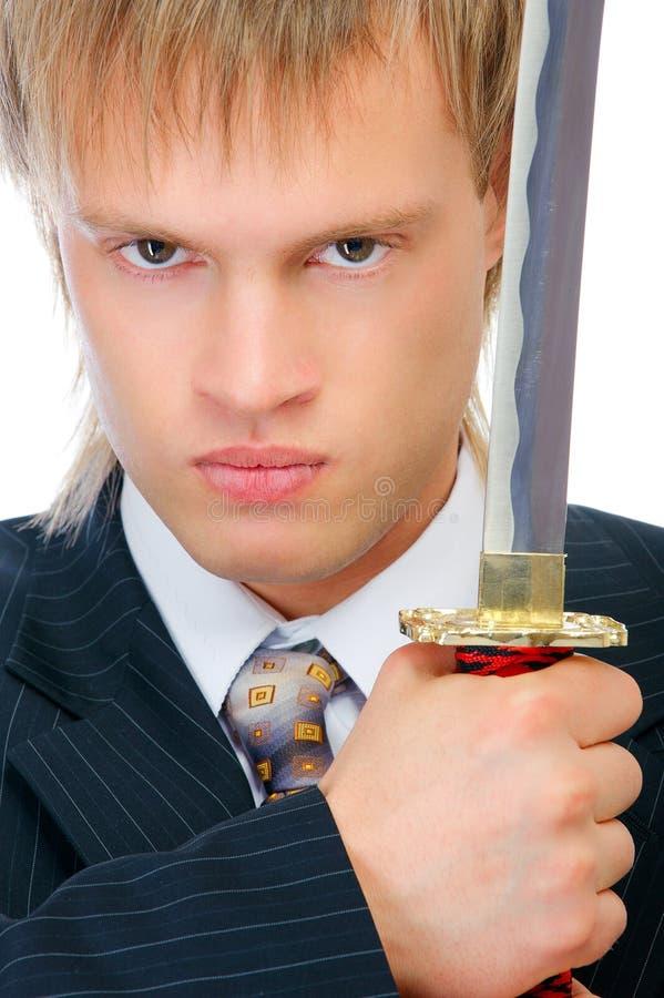 biznesowy mężczyzna ochrania kordzika zdjęcie stock