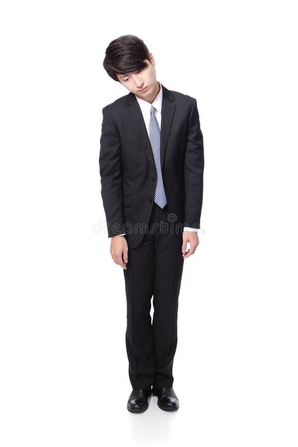 Biznesowy mężczyzna patrzeje deprymujący od pracy zdjęcie royalty free