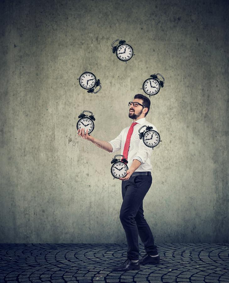 Biznesowy mężczyzna pomyślnie żongluje kierujący jego czas fotografia stock