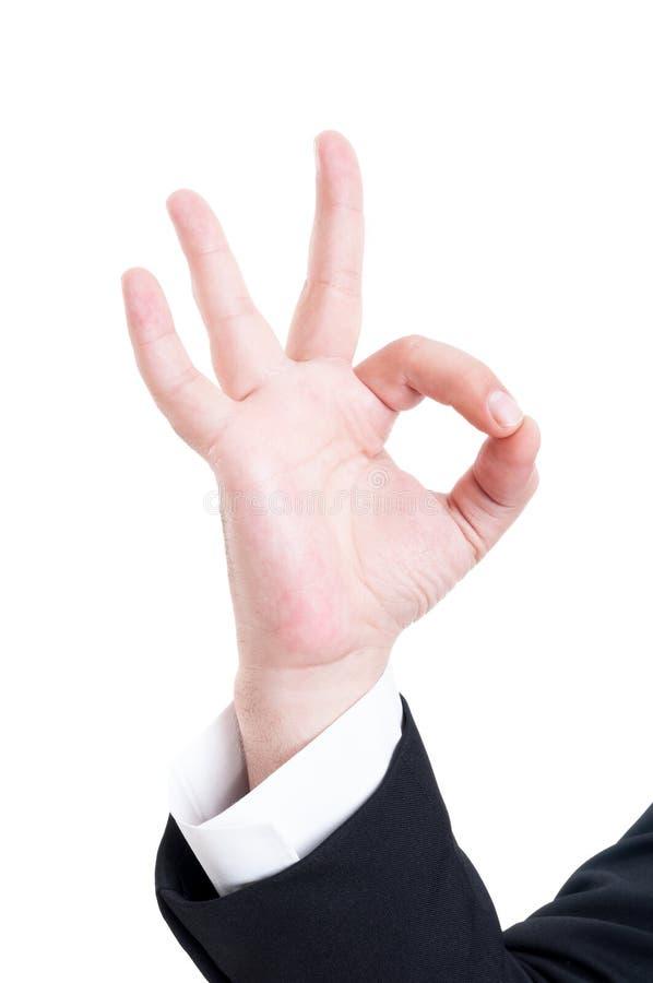 Biznesowy mężczyzna robi ok lub doskonalić gest obraz royalty free