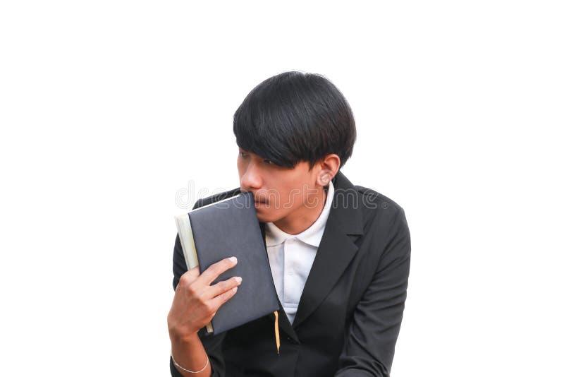 Biznesowy mężczyzna trzyma książkę na białym tle zdjęcie royalty free