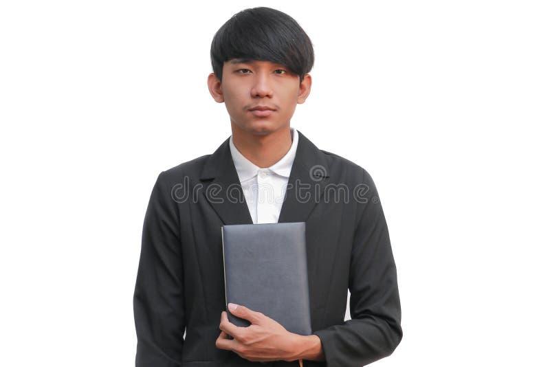 Biznesowy mężczyzna trzyma książkę na białym tle zdjęcia stock