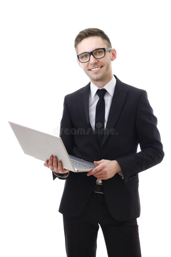 Biznesowy mężczyzna trzyma ono uśmiecha się i laptop. zdjęcia stock