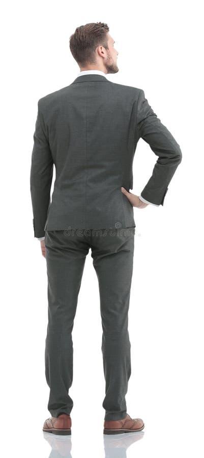 Biznesowy mężczyzna w kostiumu od plecy - patrzejący coś zdjęcie stock