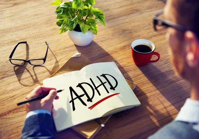 Biznesowy mężczyzna z Notepad i ADHD pojęciami fotografia royalty free
