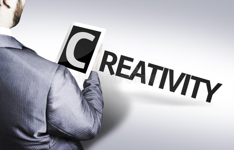 Biznesowy mężczyzna z tekst twórczością w pojęcie wizerunku obraz royalty free