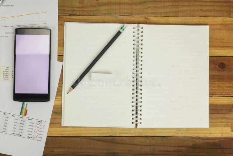 Biznesowy pojęcie biurowy działanie, Pusty notatnik z biznesowym tłem, rocznika skutek obrazy royalty free