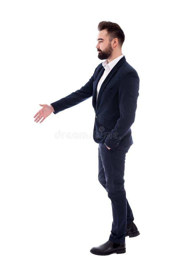 Biznesowy pojęcie - przystojny biznesmen z otwartą ręką gotową dla uścisku dłoni odizolowywającego na bielu fotografia royalty free